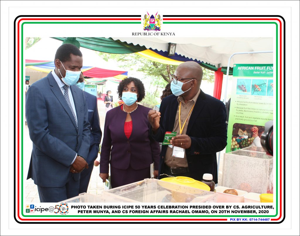 """Dr. Shepard Ndlela (ICIPE Scientist) showcasing Farmtracks 'flagship product """"BACTROLURER"""" used in the management and eradication of invasive Fruit flyBactrocera dorsalis in the presence of CS Agriculture Peter Munya and CS Foreign affairs Rachael Omamo during ICIPE's 50yrs celebration on 20th of November 2020. The product has been used by farmers for many years to effectively combat the fruit fly menace in fruit orchards in Kenya and across East Africa."""